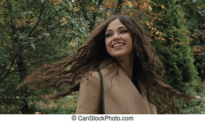 Beautiful young girl posing for a photograph in the park -...