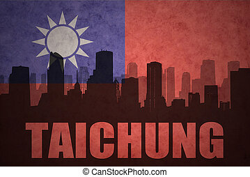 abstract silhouette of the city with text Taichung at the...