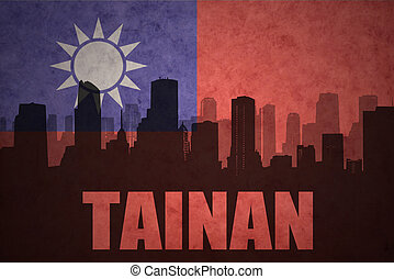 abstract silhouette of the city with text Tainan at the...