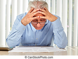 Elderly man with papers. - Senior serious man with documents...