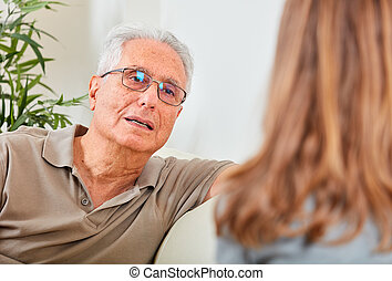 Senior man with social worker. - Old aged senior man talking...