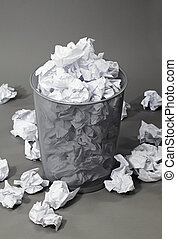 Bad ideas - A full wastepaper basket. Note: The background...