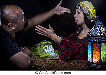Psychic Skeptic - Skeptical man arguing with a female con...