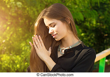 Young woman touching her hair - Young positive woman in...