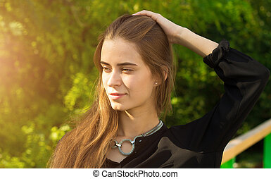 Young woman touching her hair - Young attractive woman in...