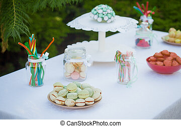 Candy bar on wedding ceremony with a lot of different...