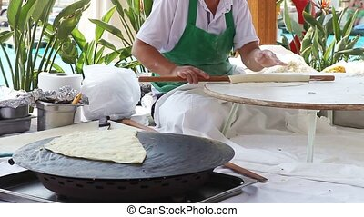 Woman Making Turkish Food - Woman prepares traditional...