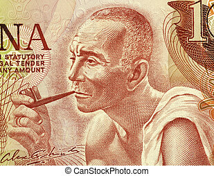 Man Smoking a Pipe - Man smoking a pipe on 10 cedis 1978...