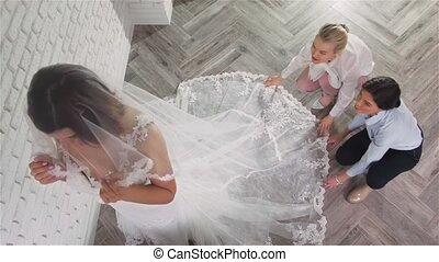 Two young beautiful brides trying her dress in shop. Wedding...