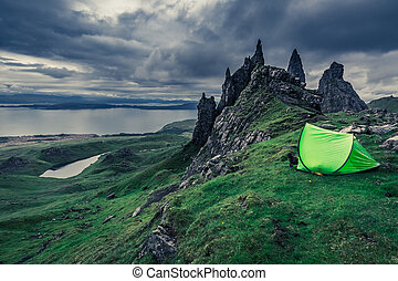 Dramatic clouds over campsite in Old Man of Storr in...