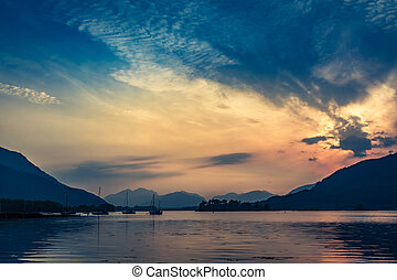 Beautiful sunset over the boats on lake in Scotland