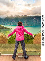 Tourist on Stegastein viewpoint, Norway - Tourist woman on...