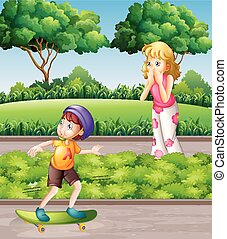 Boy on skateboard and mother in the park