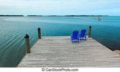Ocean pier with sun chairs