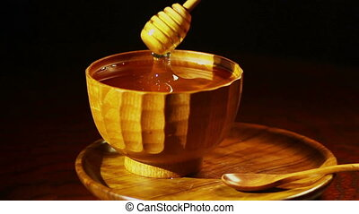 Honey In The Wooden %u0421up - Honey dripping from a wooden...