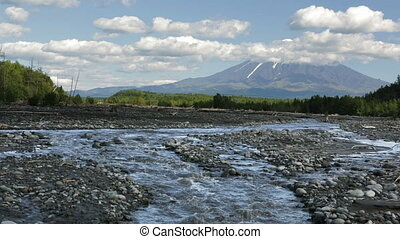 Studenaya River and the volcano Tolbachik. Kamchatka...
