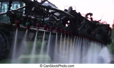 Sprayers work with the earth - Sprayer operates produces...