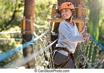 Optimistic confident woman spending time in the high wire...