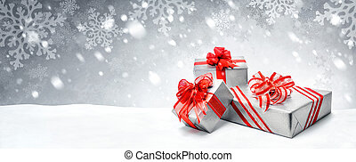 Christmas presents on snow background - Silver Christmas or...