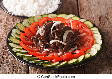 marinated roast beef Lok Lak with vegetables and a side dish...