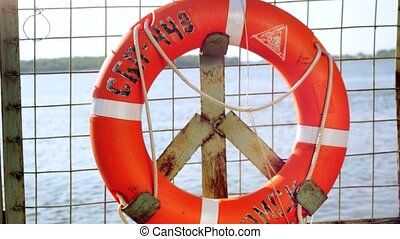 Ring life buoy on big boat .Orange lifesaver on the deck of...