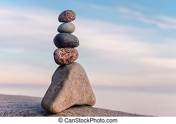 Tower of stones - Balancing some of stones on the seashore