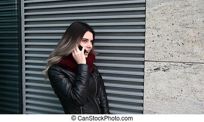 Woman talking on the telephone