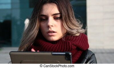 Woman using her tablet PC - Young smiling woman with long...