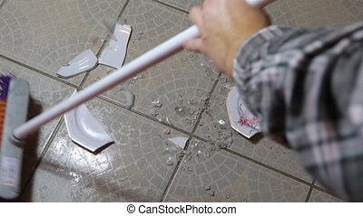 Cleaning up broken pieces - Cleaning up shattered pieces of...