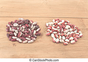 Piles of beans on wooden board