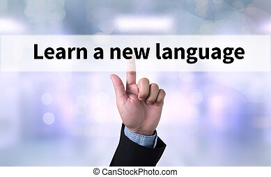 Learn a new language Business man with hand pressing a...