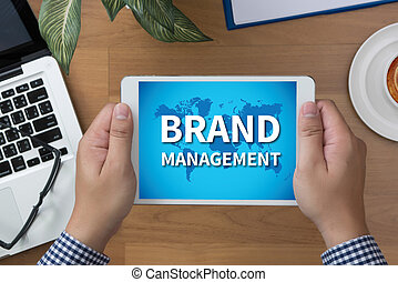 BRAND MANAGEMENT man hand Tablet and coffee cup