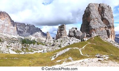 tourists hikers walking near of Cinque Torri towers...