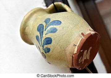 Hanging old ceramic jug