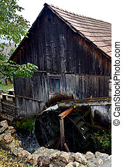 Old functional working mill wheel. Rimetea village...