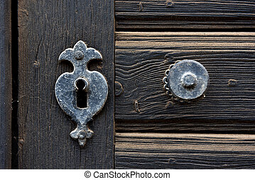 Vintage door mounting and keyhole of wooden antique door -...