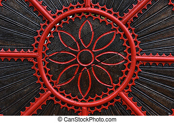 Detail of a red forged metallic gate. Forged decorative...