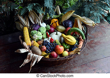 Basket of organic food vegetables, autumn goods after...