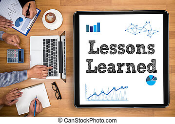 Lessons Learned Business team hands at work with financial...