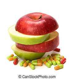 vitamins source - sliced apple and pills isolated on white...