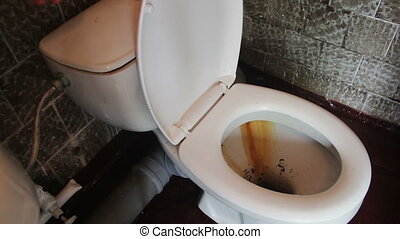 Dirty Toilet Flushes Water - Dirty rusty toilet flushes...