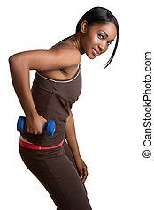 Woman LIfting Weights - Beautiful black woman lifting...