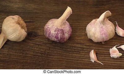 Garlic cloves and a clump of garlic - Group of single garlic...