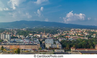 Panorama of the city center timelapse of Zagreb, Croatia, with modern and historic buildings, mountains on background.