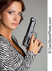 Woman Holding Gun - Beautiful latin woman holding gun