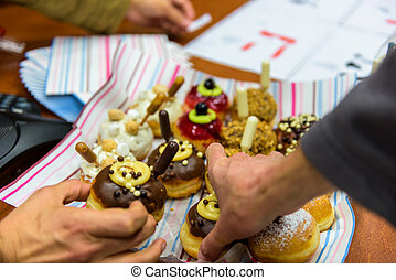Hanukkah celebration with various decorated donuts...