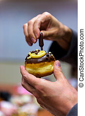 Hanukkah celebration with decorated donut (Sufganiyah)