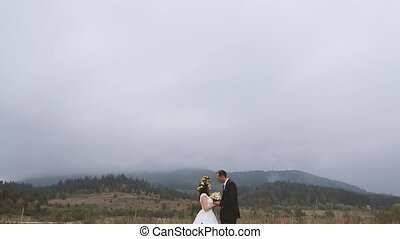 Wedding Bride and Groom Kissing on the Walk