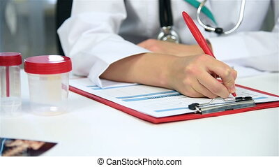 Doctor Filling Medical Card - Woman Doctor Filling Medical...
