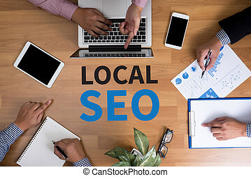 Local SEO Concep Business team hands at work with financial...